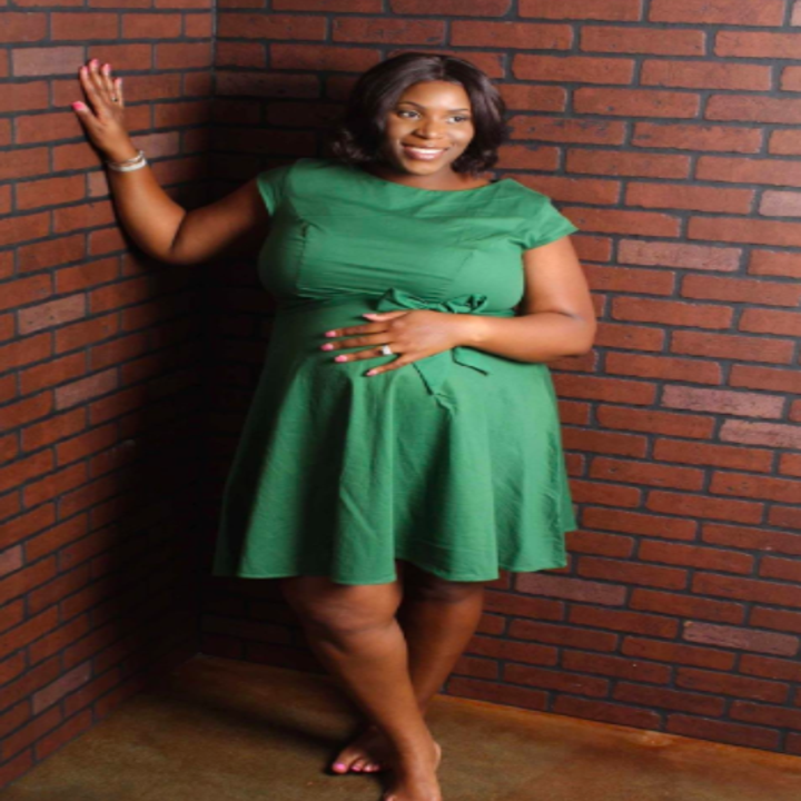 A reviewer wearing the knee-length, short-sleeve, A-line dress in green