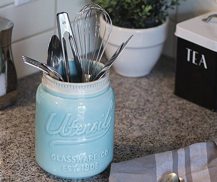 """The jar is dishwasher-safe.Promising review: """"I love this utensil holder. The color is beautiful and it's big enough to hold plenty of kitchen utensils. It was well-packaged, so it arrived in pristine condition."""" —Marlark Price: $23.99 (available in two colors)"""
