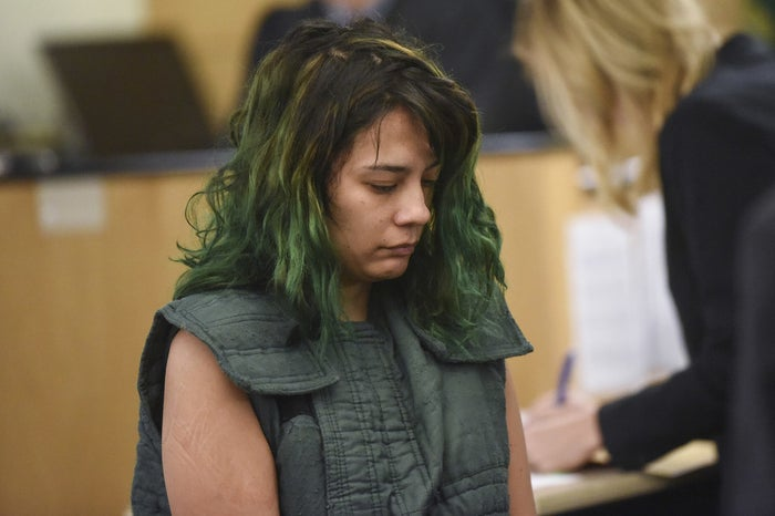 Emily Javier makes a first appearance in court on allegations that she stabbed her boyfriend with a samurai sword at their home in Camas, Washington.