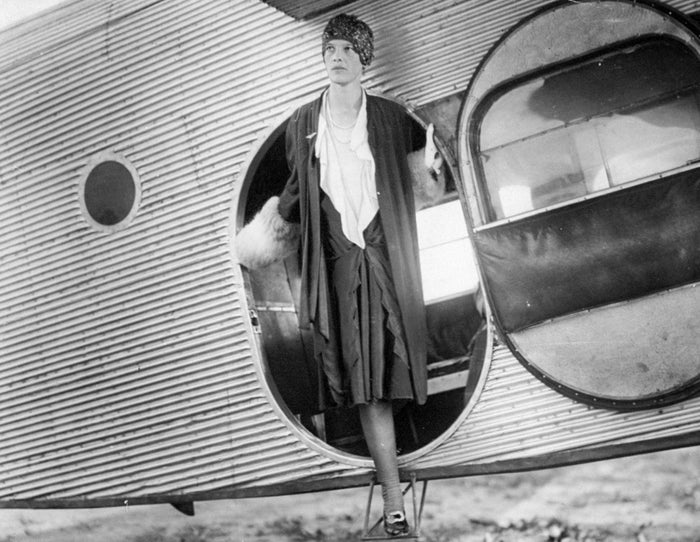 Amelia Earhart steps out of the cabin of her plane at Curtiss Field on July 9, 1928.