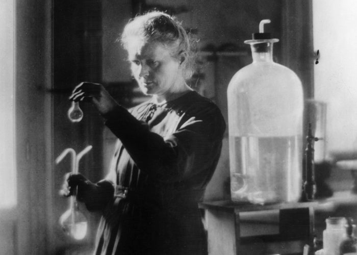 Marie Curie conducts experiments on radioactivity in her laboratory, 1905.