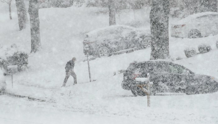 Heavy snow is seen Wednesday in Springfield, Pa.