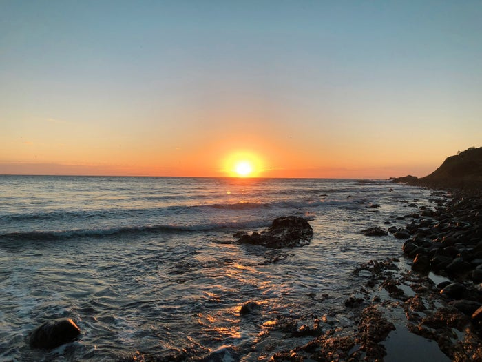 If you are close to Saltwater National Park, you should try and get up early to capture the stunning sunrise over the rocky beach. This surfing spot is a local favourite, so you may be able to take some shots of the great Australian lifestyle... or even catch a wave or two yourself.