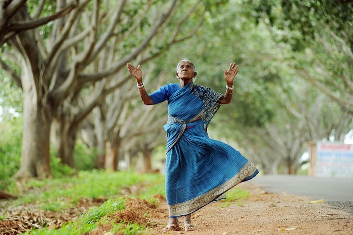 """Across cultures, women unable to bear children naturally battle with the stigma of being infertile. Thimmakka, born to a poverty-ridden family in rural Karnataka, southwest India, was no exception. When she and her husband could not conceive despite years of trying, Thimmakka decided that she would plant trees and care for them as her offspring instead. Thimmakka began to plant her babies on a 4-kilometer stretch near her village, protecting each sapling from the elements, animals, and other predators with her husband, until every one of them grew into a gigantic and independent tree. Along with several state and national honours, Thimmakka was given the title of """"Saalumarada,"""" which means """"row of trees."""" Now 105 years old, Thimmakka has planted over 400 banyan trees in her lifetime, and has finally passed on the responsibilities of looking after her green family to a foster son."""