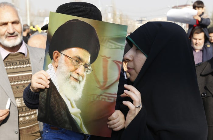 An Iranian woman holds a child carrying a portrait of Ayatollah Ali Khamenei at pro-government demonstrations in Tehran earlier this year.