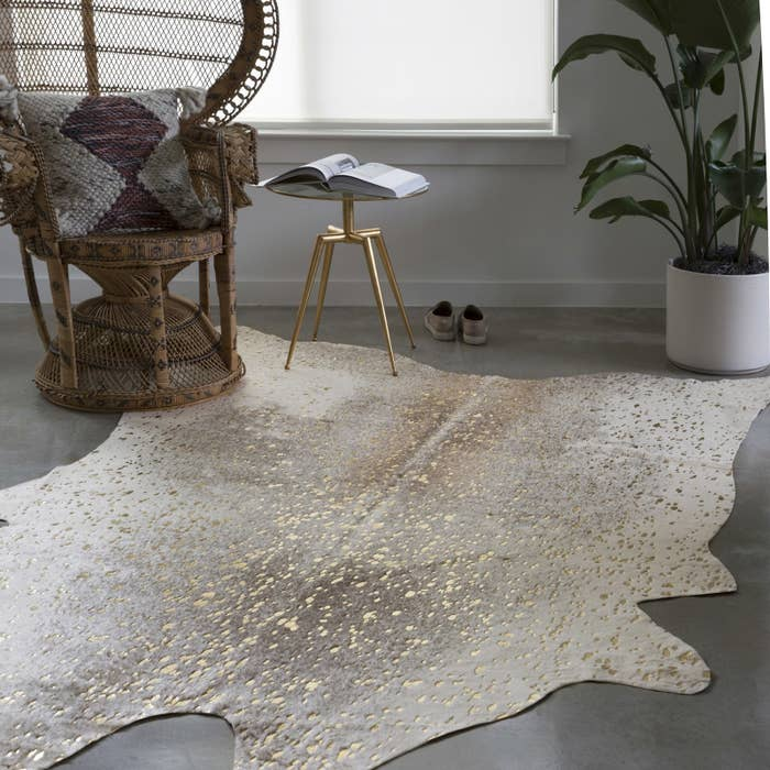 """Promising review: """"The rug is super cute. Looks exactly as pictured and is PERFECT for my home. We've gotten so many compliments on it, and it's pretty durable even with a very excited puppy trampling it everyday. :) We're happy customers."""" —OstkUser27257281Price: $141.09 (retail: $275)"""