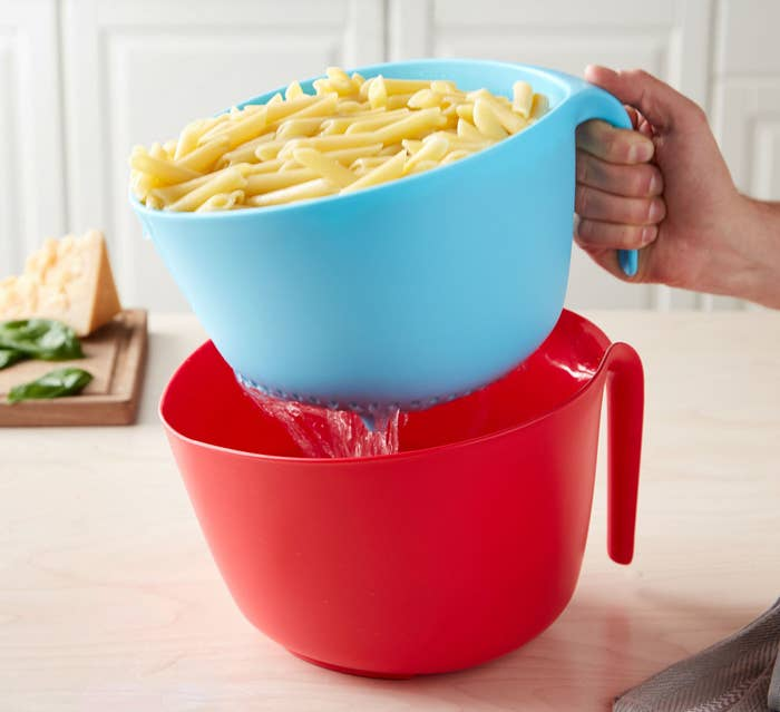 "Promising review: ""Where has this been all my life! I cook pasta at least once a week and I'm always fearful of carrying the pot full of boiling-hot water over to the sink to drain the water. With this two-piece colander set, I can drain the pasta right at the stove and also safely preserve some of the pasta water so that the pasta does not stick together. This set comes in cool colors (red and blue) and spices up my relatively boring set of kitchenware. I look forward to using this set over and over again!"" —CrystalGet the two-piece set from the Tasty collection for Walmart for $12.44 (available in red/blue and royal blue/blue)."