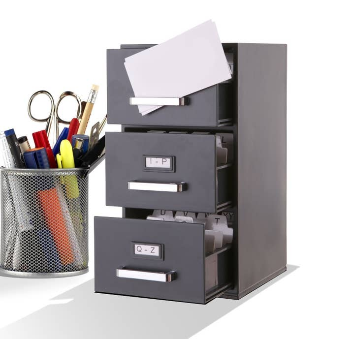 6 Speaking Of Filing Cabinets A Tiny One To Keep Your Business Cards In What Is This An Office For Ants