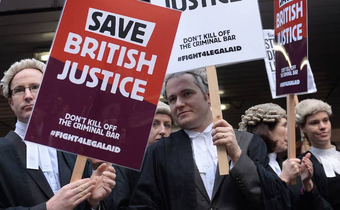 Barristers outside Southwark Crown Court, London, during a nationwide strike against Government plans to cut legal aid in 2014.
