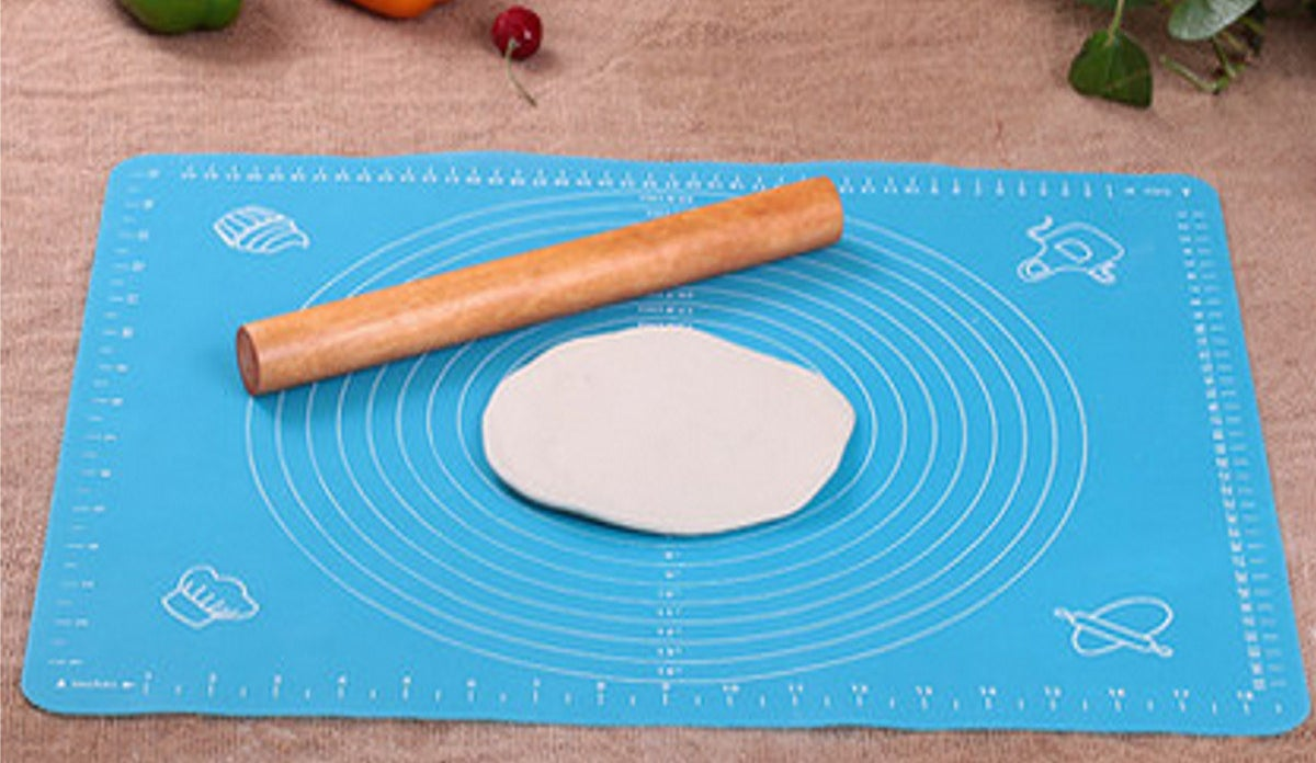 A silicone rolling mat that'll make flattening your dough easy peasy, lemon (bar) squeezy.