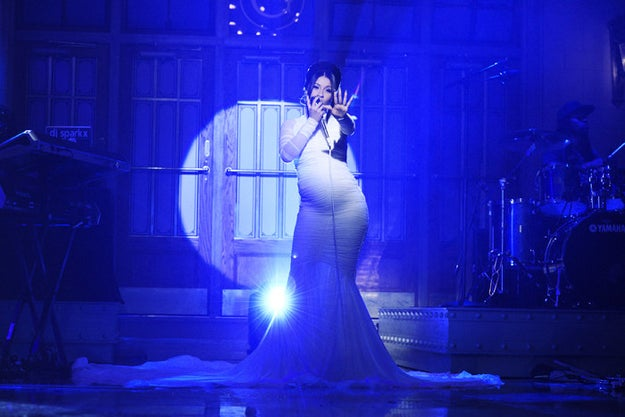 "Over the weekend, ""The Trap Selena"" was the musical guest on Saturday Night Live where she officially revealed her pregnancy, performing hit single ""Be Carfeul"" in a custom Christian Siriano gown."