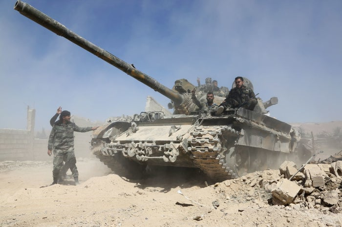 Pro-government forces advance toward the town of Douma, Syria. Rebels withdrew on Monday.