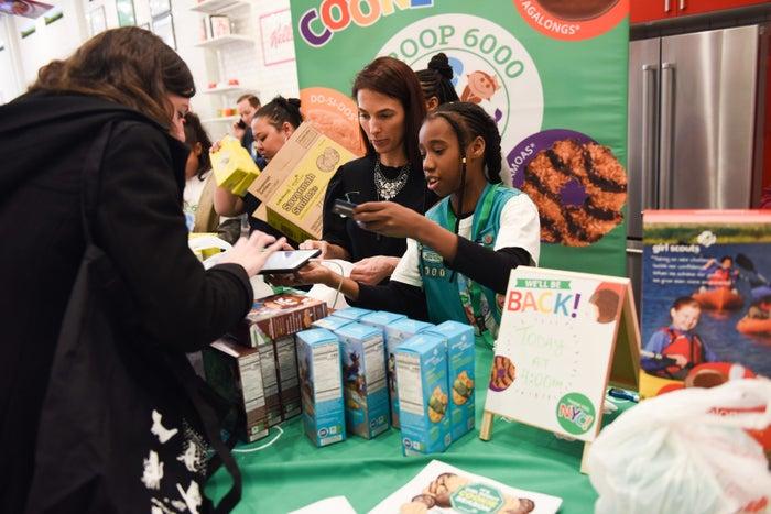 Sanaa, 10, selling cookies to a customer.
