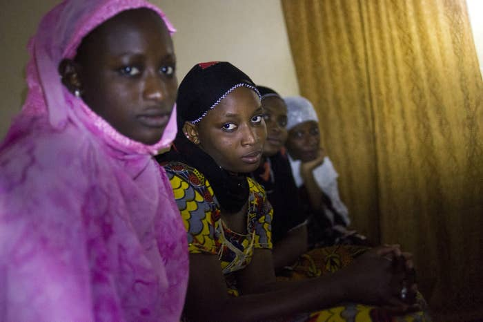 Malian women pose during a dinner in their home, on Jan. 31, 2013, shortly after Timbuktu was recaptured from Islamist militants by French-led forces.
