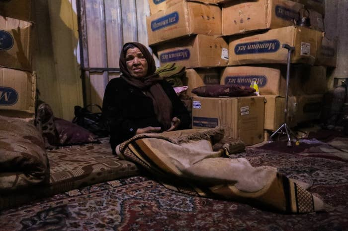 """Sitting next to her family's belongings, U said, """"I hope the world will look at me, listen to my voice, and stand with me. I wish to go back to my home with my family."""" Many are worried that the structures they live in won't take any more shelling — and are especially worried for the fate of their children."""