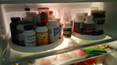reviewer pic of top shelf of fridge with vitamin bottles organized on two lazy susans