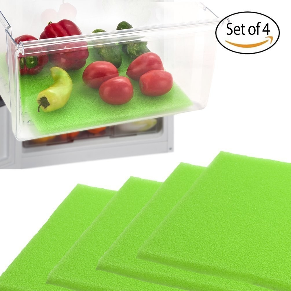green foam sheets and one shown in a produce drawer as a liner