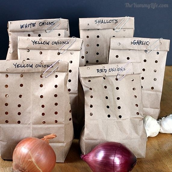pic of labeled brown paper bags with holes punched in them for onions, garlic, and shallots