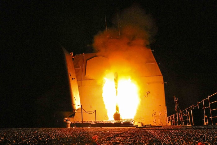 In this handout photo, the guided-missile cruiser USS Monterey (CG 61) fires a Tomahawk land attack missile on Saturday.