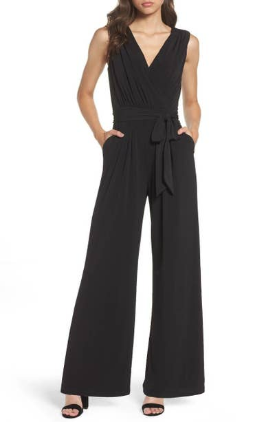 29d6db12682 An elegant AF Vince Camuto faux-wrap jersey jumpsuit you can totally rock  at that summer wedding you ve got coming up.