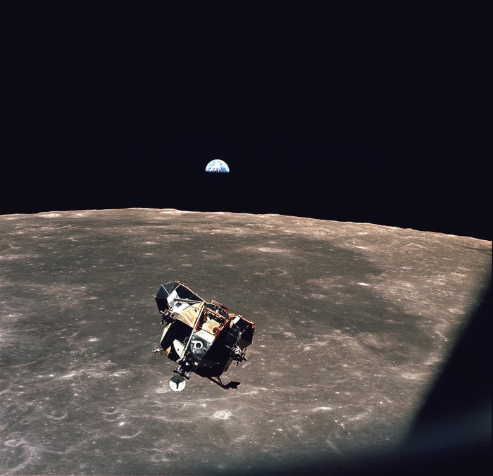 The photo was taken by the astronaut Michael Collins while Neil Armstrong and Buzz Aldrin were returning to the command module for the journey home after having landed on the moon. With the Earth in the background, it's a photo of everyone who was alive at the time. (Except for Michael Collins, of course.)