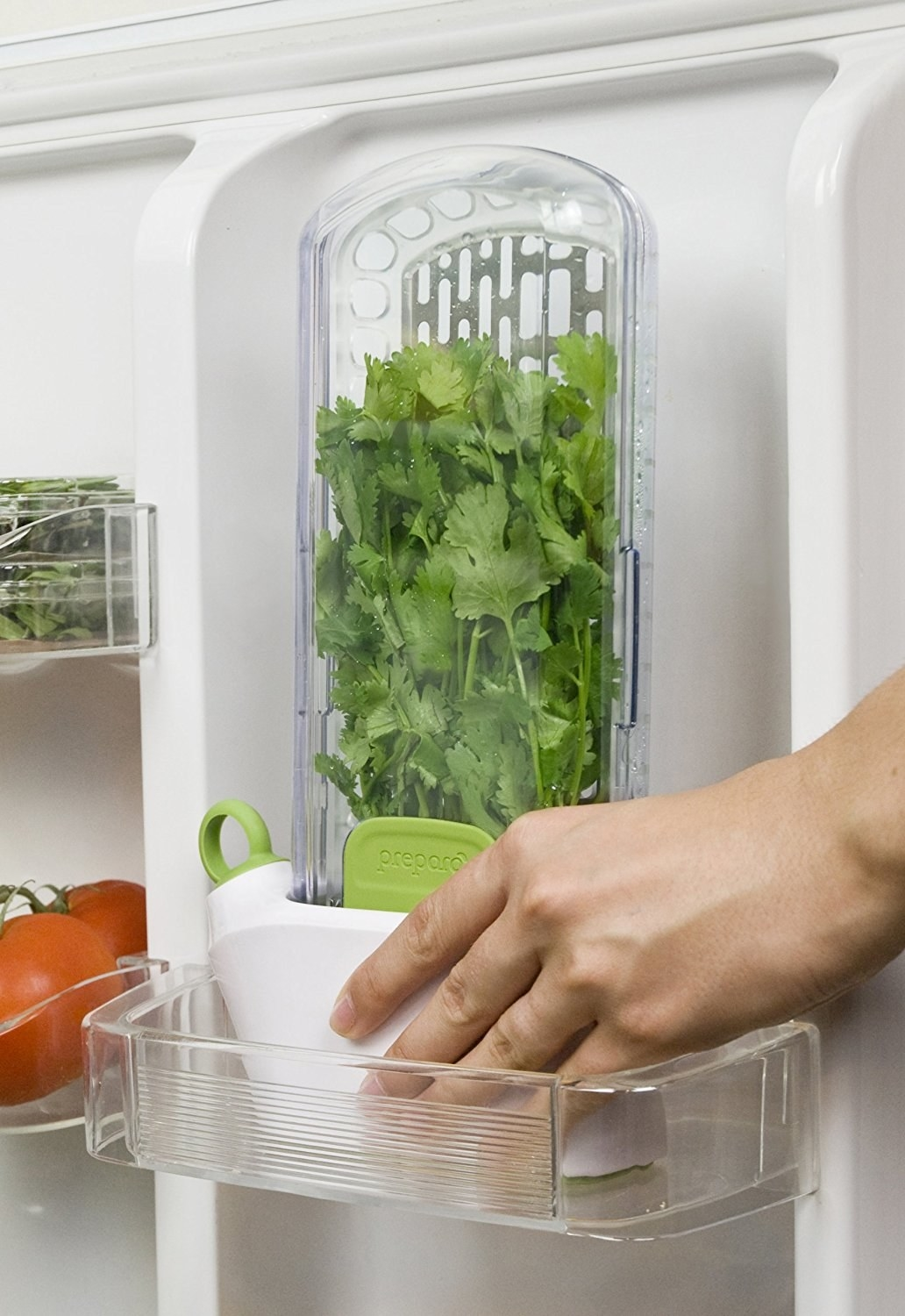 fridge door shelf with the vertical storage unit that holds the herbs inside