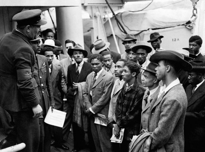 Jamaican immigrants are welcomed by RAF officials from the Colonial Office after the ex-troopship HMT Empire Windrush landed at Tilbury in 1948.