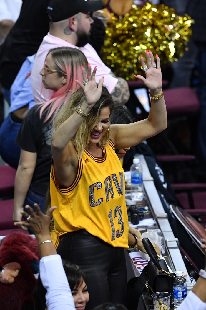 Khloé wearing Tristan Thompson's jersey at a Cavs game last year.