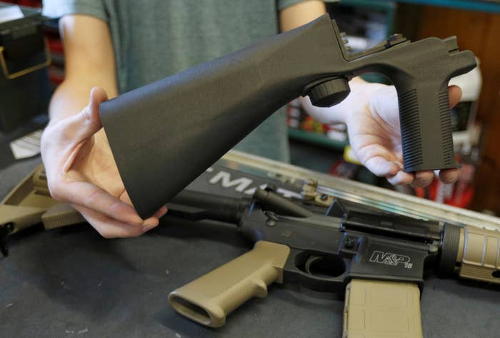 A bump fire stock that attaches to a semi-automatic rifle to increase the firing rate.