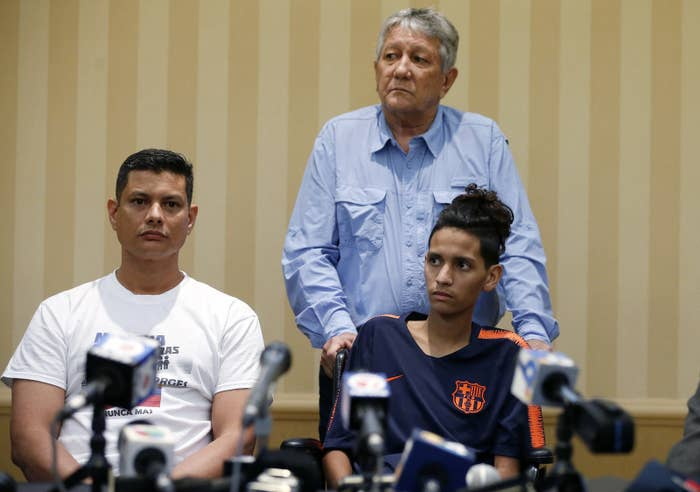Roger Borges (left), father of Marjory Stoneman Douglas High School shooting victim Anthony Borges (right) and Alfredo Borges (center) address the media at a press conference on April 6, 2018.