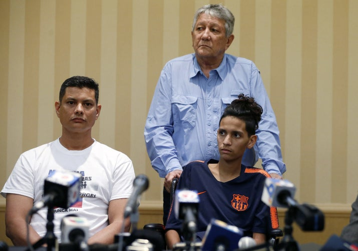 Roger Borges (left), father of Marjory Stoneman Douglas High School shooting victim Anthony Borges (right) and Alfredo Borges (center) address the media at a press conference in Plantation, Florida, on April 6, 2018.