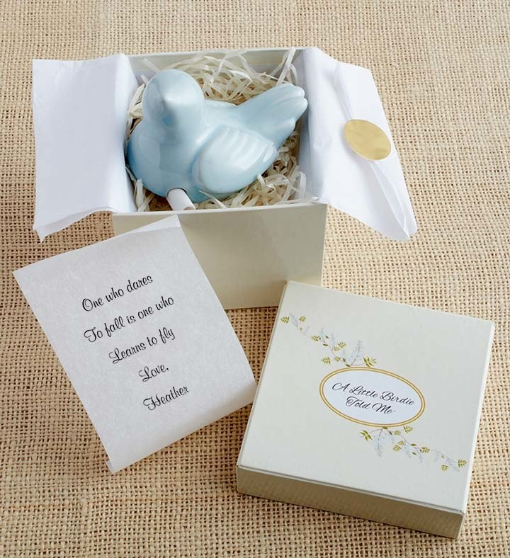 the blue stone bird and message scroll in its box