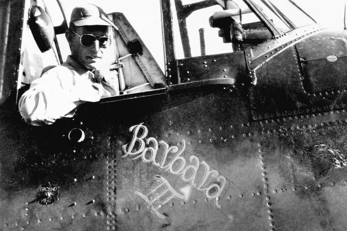 """George Bush sits in the cockpit of his torpedo bomber """"Barbara III,"""" named after his girlfriend and future wife, Barbara Pierce, circa 1943."""