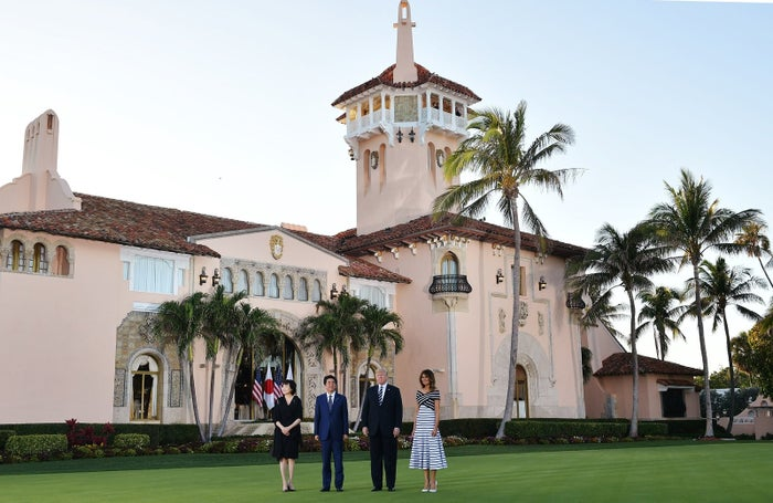 Donald and Melania Trump greet Japan's Prime Minister Shinzo Abe and his wife Akie Abe as they arrive for dinner at Trump's Mar-a-Lago resort.