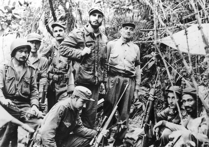 This photo, filed June 1957, is believed to be the only existing one of Fidel Castro leading Cuba's revolutionary forces, with members of his staff and troop commanders, and was taken at a secret base.