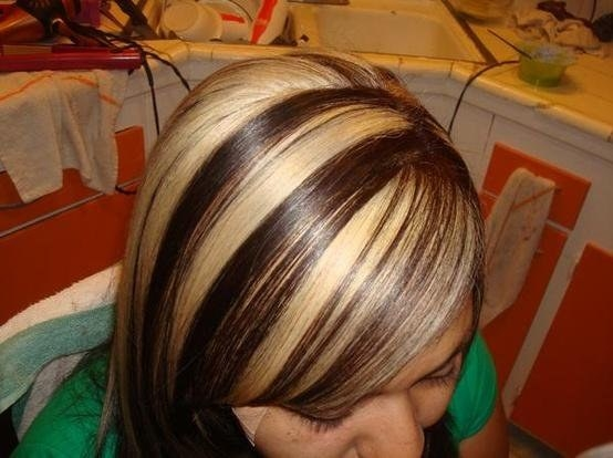 A photo of the top of a woman with chunky highlights head