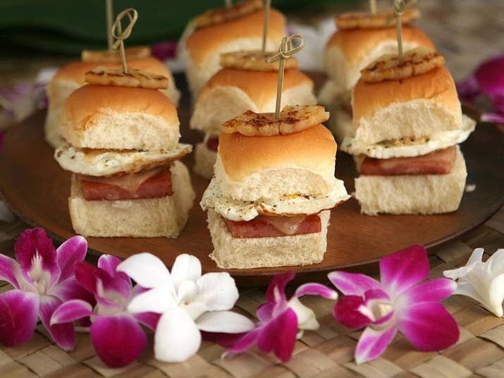 Let's be real. We all know Hawaiian pizza is the best pizza. These sliders channel that harmony of ham and pineapple for one delicious dish. Find the recipe here.