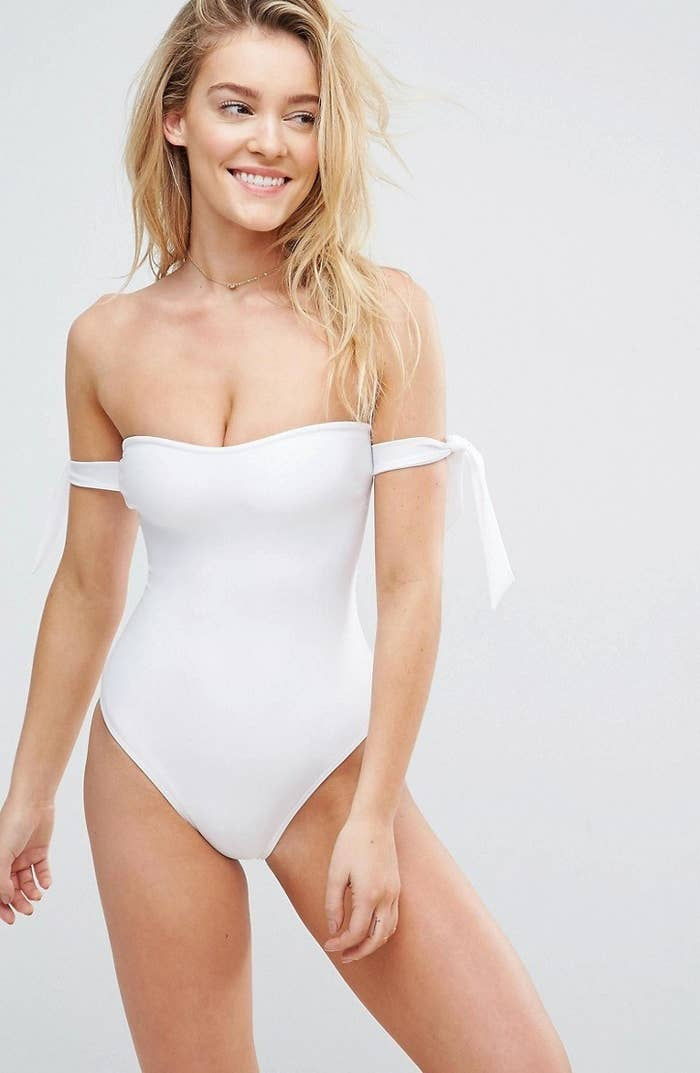 251c9a1f87d30 An off-the-shoulder swimsuit with adorable shoulder ties you'll fall in  love with. I guess you could say it'll tie you down.