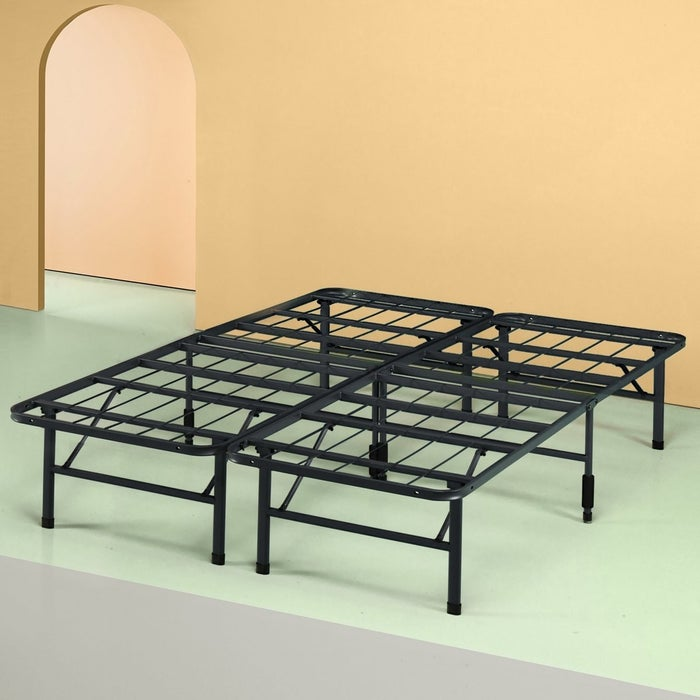 """Promising review: """"I love this sturdy and simple bed frame! It's really cool because it collapses down. In a matter of minutes, the frame is only two inches thick and can be carried out easily by one person. That would be great for home staging but I use it all the time. Totally worth the price, and if you shop strategically on Amazon, you can get a really high-end look for pennies on the dollar."""" —Charlie Get it from Amazon for $60.99 (available in four styles and seven sizes). Or find other other classy options that don't cost a fortune. Check out our full view of the Zinus bed frame."""