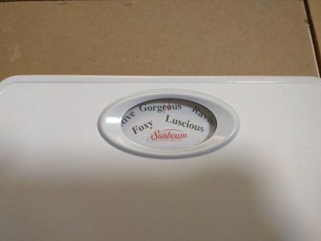 This husband who replaced the numbers on his wife's scale with words describing how he sees her: