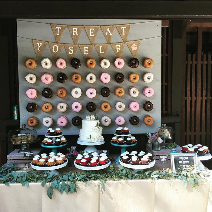 Who doesn't love a good donut? A donut wall creates an unforgettable backdrop for your dessert table, that will leave a lasting impression. Guests will love this creative and trendy idea.