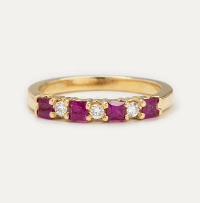 8062c12baf6 ... yellow-gold band studded with diamonds and either rubies or emeralds