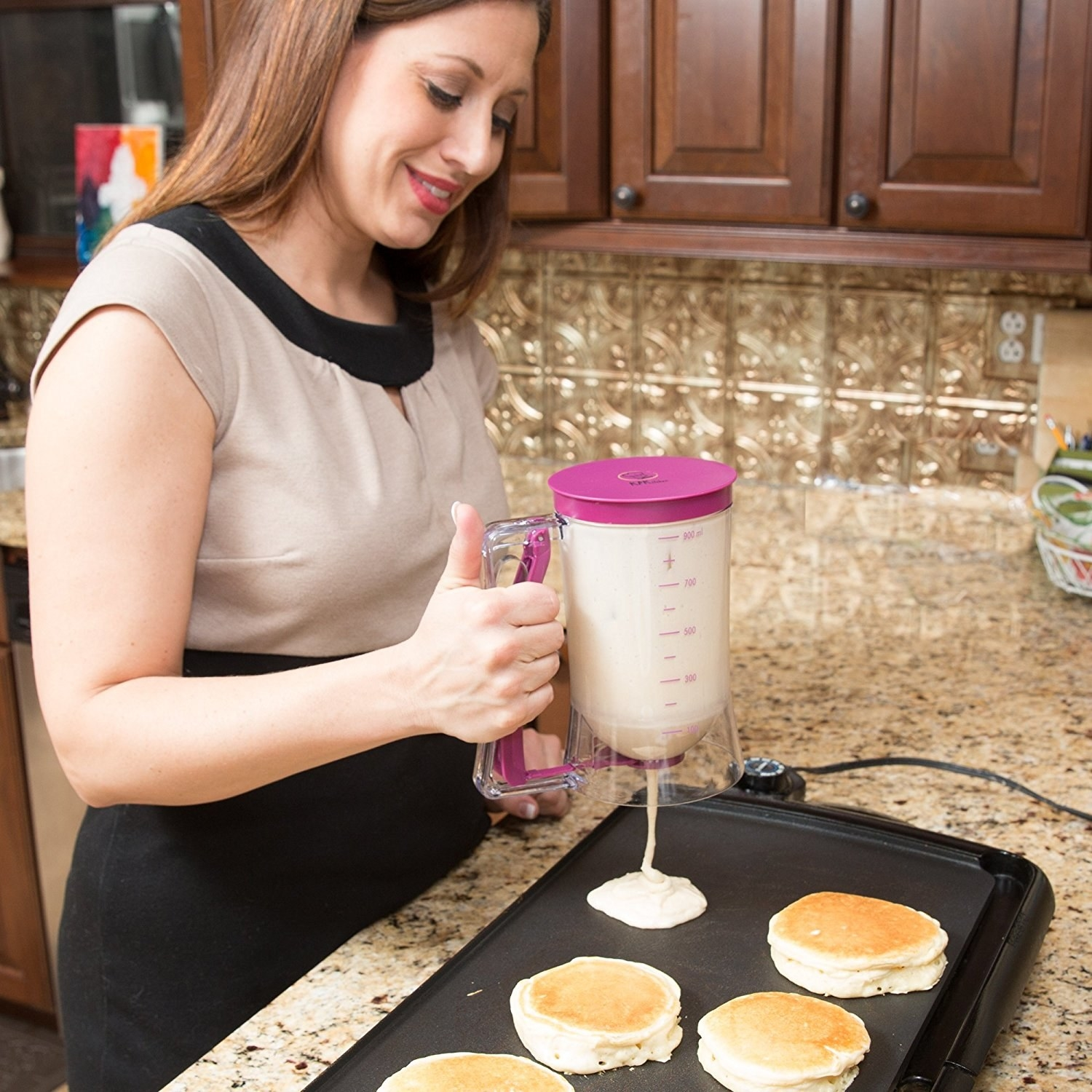 Model dispensing the batter by pulling the handle lever, to make evenly size pancakes
