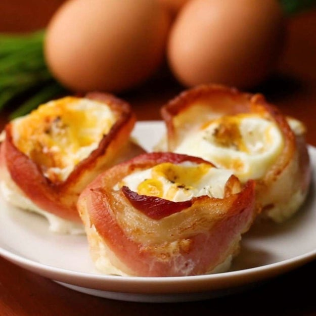 Swoon-worthy bacon egg cups that'll basically done in two simple steps – place the bacon in the muffin tin, bake, and then crack and egg into it.