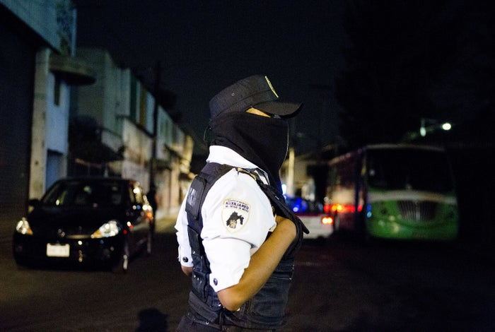 A masked police officer stands outside the immigration detention center in Mexico City in 2015.
