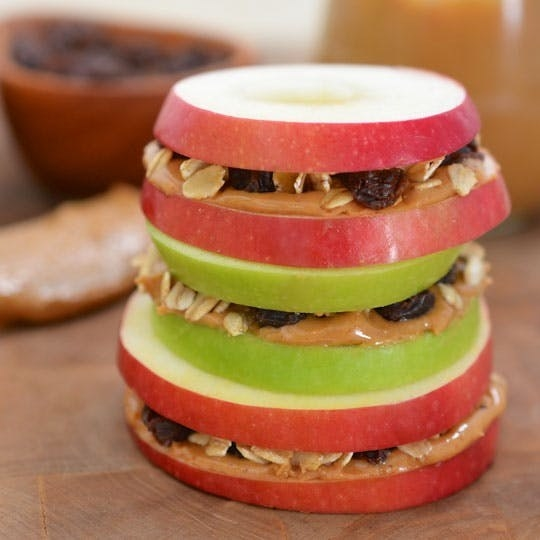 Apple Sandwiches with Honeyed Peanut Butter, Oats, and Raisins