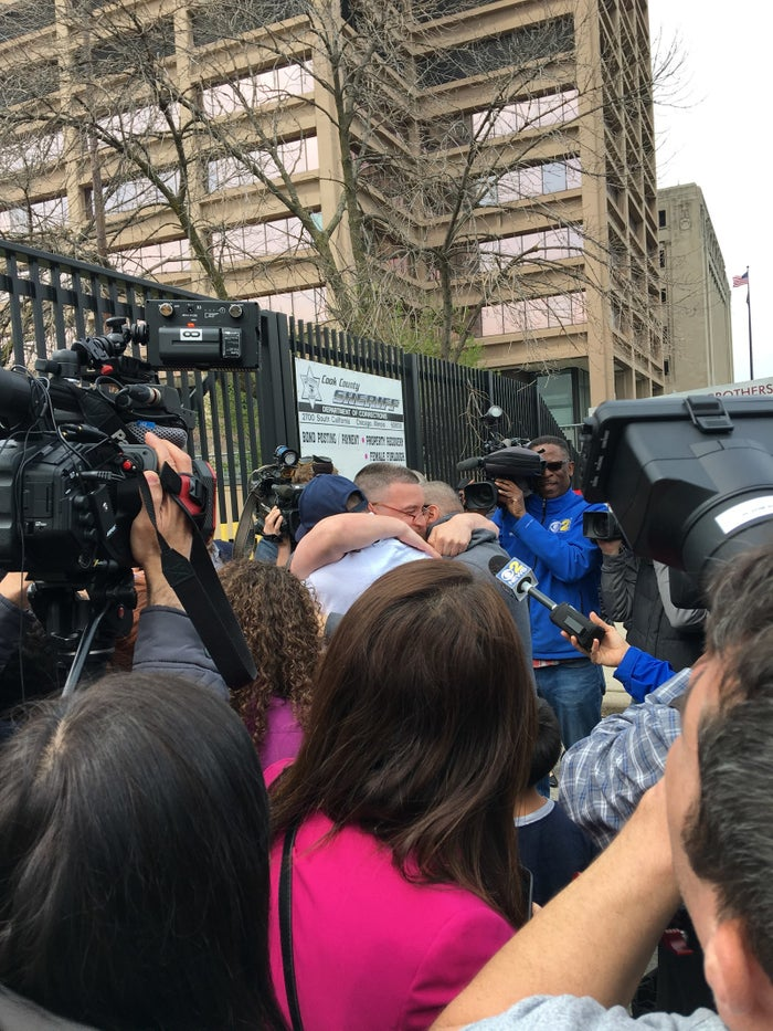 Roberto Almodovar (center) flanked by family and press last April as he walked out of prison for the first time.