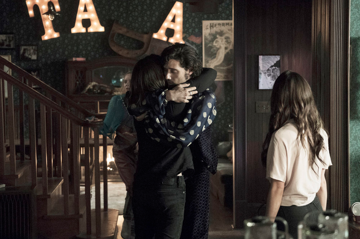Hale Appleman as Eliot, embracing Summer Bishil as Margo in The Magicians.