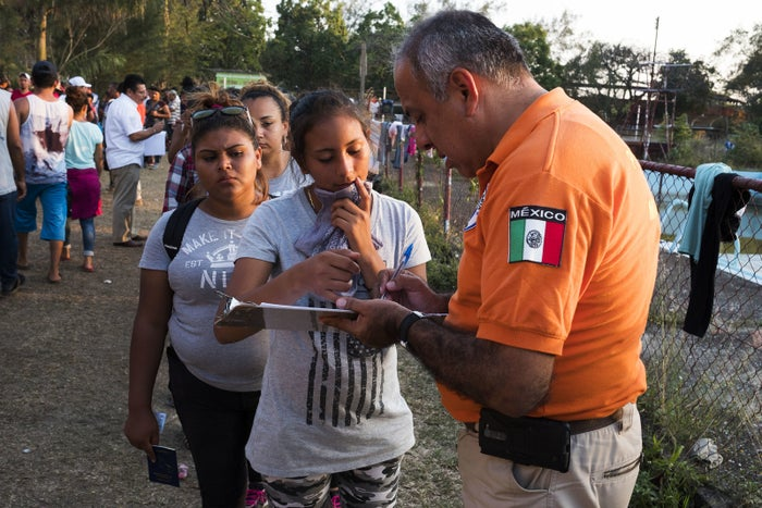 Migrants line up to speak with Mexican immigration officials with Grupos Beta. Some will apply for humanitarian visas in Mexico while others will ask only for transit visas to travel north towards the US or back to their home countries.