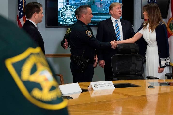 First lady Melania Trump shakes hands with Officer Michael Leonard.